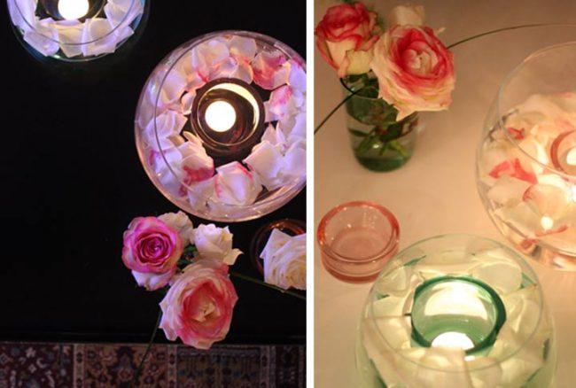 mit Rosenblättern und Teelichtern gefülle Glasschalen