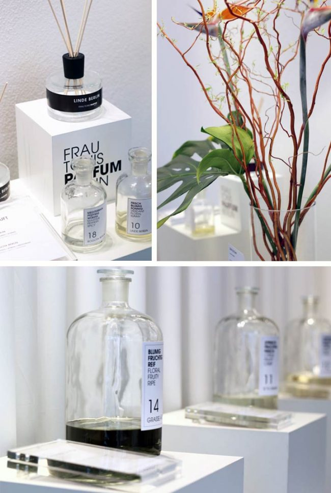 Bild mit Parfum Flakons und Raumduft und Blumen im Geschäft bei Frau Tonis Parfum Berlin