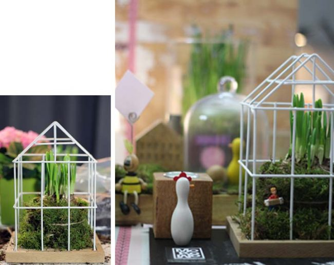 Bild mit Gitterhaus, Holzfiguren und Frühlingsblühern als Frühlingstrend